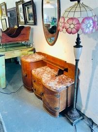 Marble top vanity, beveled oval mirror. Vintage floor lamp & unusual shade