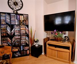DVD's galore and TVs for sale. More clocks.
