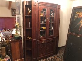 A wonderful hall or dining room display cabinet made of cherry wood with side shelving. Not too big,perfect size for any size room. Screen from the 1920's