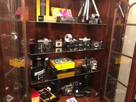 Camera's--all types, from all different years. Pentax, Brownie, Instamatic and Too/Five lense's