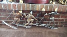 Mid Century handmade mixed metals wall hanging of 4 skiers, has a nice weight to it