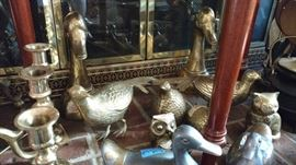 A lot of brass, matching pheasants, owls, ducks, kitty, candle holders and door knockers
