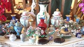 there are Asian ginger jars, large beautiful vases, cloisonné jars, Noritake' assorted pieces and many,many more
