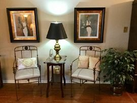 Pair of custom iron side chairs; Stiffel lamp; Nice art fashion prints