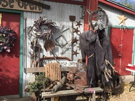 Outside the Warehouse, great wood bench, lots of seasonal decorations, vintage garden tools