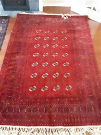 Bokhara with traditional reds, browns and creams. Great condition, rarely used. Exceptional details in the design. 6'x9'.