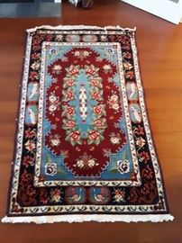 Caucasian rug, wool on cotton. 3'x6'.  Beautiful design with bright blues, reds and greens.  Most Caucasian rugs come from Azerbaijan.