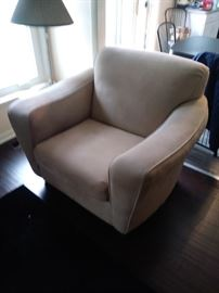 Overstuffed chair in beautiful condition Which also has a matching couch