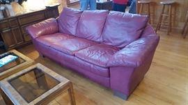 One of two Natuzzi Burgundy Leather Sofas