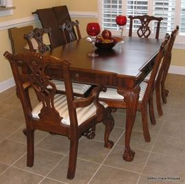 Beautiful Large Dining Table with two extra extensions and 6 chairs, two of which are Captains. Drawers at both ends. Pads also. Table is 67 inches long with 2 18 inch extensions.