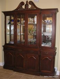 Large Display Hutch, beautiful carved pieces, glass shelves, much nicer in person. Matches the Dining Table. Hutch measures 89 inches tall, 70 inches wide, 18 inches deep