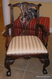 One of the Captain Chairs that goes with the Dining Table.