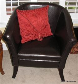 TWO matching Black barrel Armchairs, very nice and also very comfortable.