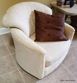 Beautiful Ivory color swivel rocker barrel style chair