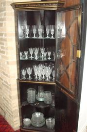 Oriental cupboard shown with contents.