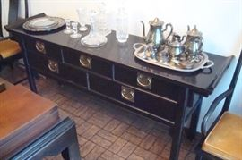 Oriental style sideboard and item on top.
