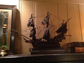 This very old sail ship is handsome decor for this massive fireplace.
