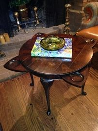 "Rotate the top of this impressive antique table, and the ""coasters"" disappear."