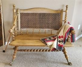 Antique settee and vintage blankets for sale.