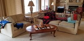 Lots of sofas for sale.