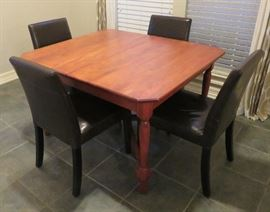 Breakfast table with three (3) leaves, Crate and Barrel leather chairs (4)
