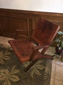 Safari chair (from Peru) rawhide leather -- there are two (one of the seats does have slit)