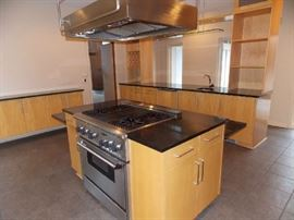 island thermodore stove grill stainless steel hood granite countertops