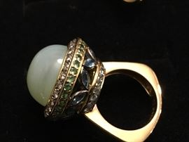 18K gold ring - the main stone is Chalcedony quartz and it surrounded by Diamonds along with Garnets and Aquaramines and Blue Zircon - the ring is a size 7