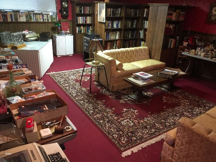"""This huge room is full of books, collectibles and a """"split sofa"""""""