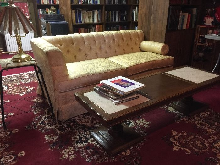 """Marble inserted coffee table, one side of """"double"""" split couch."""