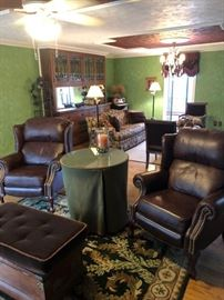 "The living room of this home is full of furniture in ""like new"" condition.  Leather recliners, upholstered sofa, mohair side chairs, area rugs and more."