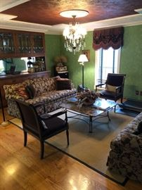 Mohair side chairs, glass top coffee table, window treatments, bar accessories.