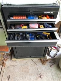 Toolbox full of tools.  Screwdrivers, hammers, wrenches, socket sets, measuring tapes and more.