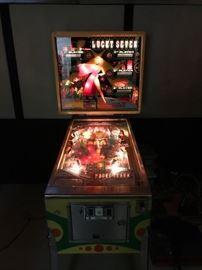 """LUCKY SEVEN"" pinball machine.  Needs some TLC to get working."