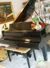 Kawai GE-1 grand piano. We had it professionally tuned today, and put through its paces. Appraiser's findings will be available for interested parties. Played very little, extremely well-maintained.