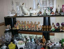 Hummels, Goebel ducks, cut crystal, bells, a dragonware vase, Riedel sommeliers wine glasses (signed). Peeking behind the Goebel ducks is a Bjorn Wiinblad vase by Rosenthal.