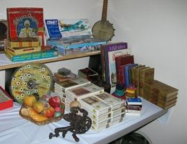 Vintage games including a Whizzer Quizzer! Plane models, a BANJOLELE, Tom Swift books, House of Miniatures doll house furniture kits, Alabaster fruit and eggs.