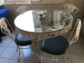 Mid Century Woodard iron table and 4 chairs
