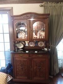 Carved Hutch and Dishware