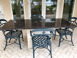 Incredible stone table with a marble top and four metal chairs