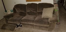 There are 2 of these recliner couches in the living room