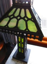 Cast iron arts and crafts lamp with slag glass