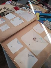 Scrapbook of vintage baby announcements and cards