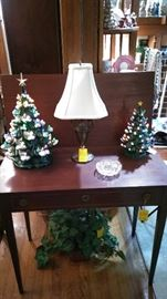 Lighted ceramic Christmas trees on mahogany game table