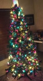 7 ft light up Christmas tree and we have tubs of ornaments