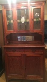Beautiful hutch and cabinet! They are detachable. Lovely stained glass hutch doors! Great for storage and display.