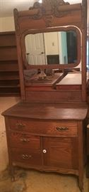 Beautiful vanity! Gorgeous wood carving on the tilt mirrors and great storage below.