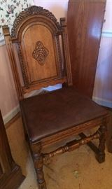 Previous mentioned wood carved chair with leather-type seat. Behind it is the second lead to the dining room table.