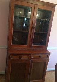 Pretty cabinet and hutch with lots of storage!