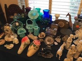 Aqua blue Fenton glass pieces, floral wall pockets, blenko pitchers, ornate floral anniversary clock, collection of rock crystals, franz mom & baby giraffe figurines